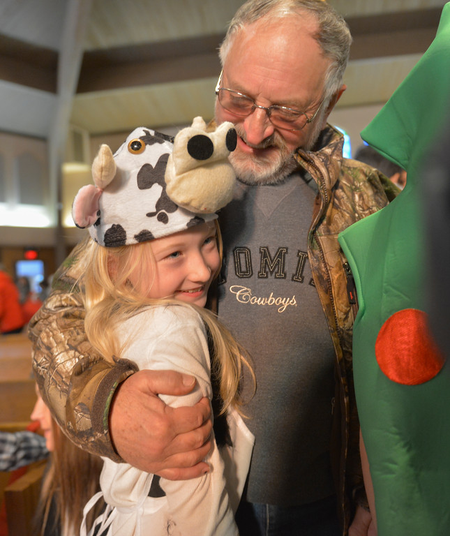 "Justin Sheely | The Sheridan Press<br /> Eight-year-old Emma Sutton receives a hug from grandfather Jerry Anderson at the conclusion of the nativity program ""Through a Child's Eyes"" at Holy Name Catholic Church Wednesday, Dec. 20, 2017."