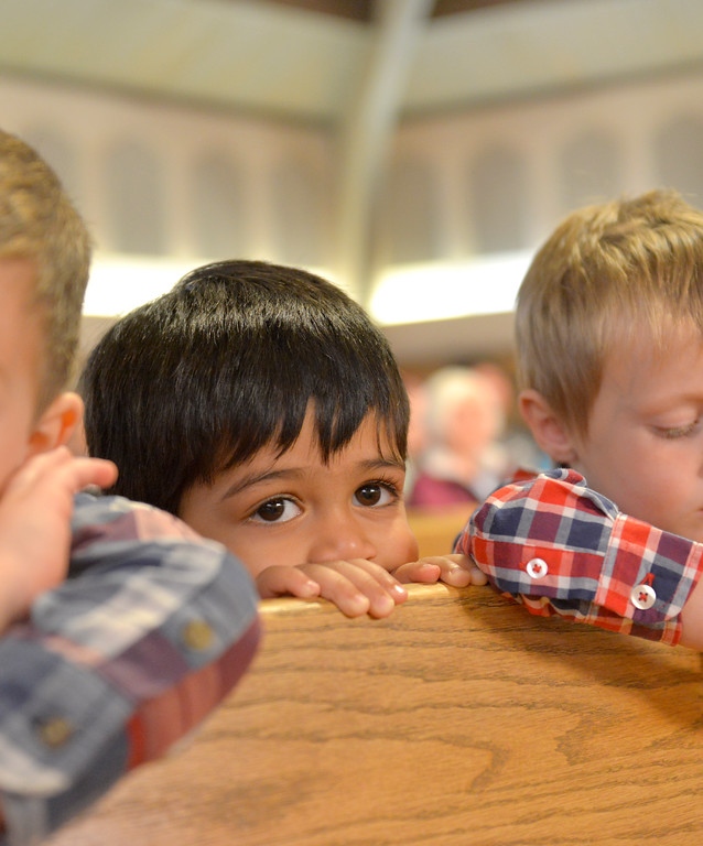 "Justin Sheely | The Sheridan Press<br /> Pre-kindergartener Viaan Kerkar looks on during the nativity program ""Through a Child's Eyes"" at Holy Name Catholic Church Wednesday, Dec. 20, 2017."
