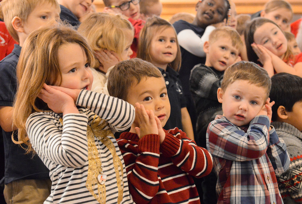 "Justin Sheely | The Sheridan Press<br /> Pre-kindergarteners, from left, Mikah Raley, Joseph Rakowski and Bradley Green sing during the nativity program ""Through a Child's Eyes"" at Holy Name Catholic Church Wednesday, Dec. 20, 2017."