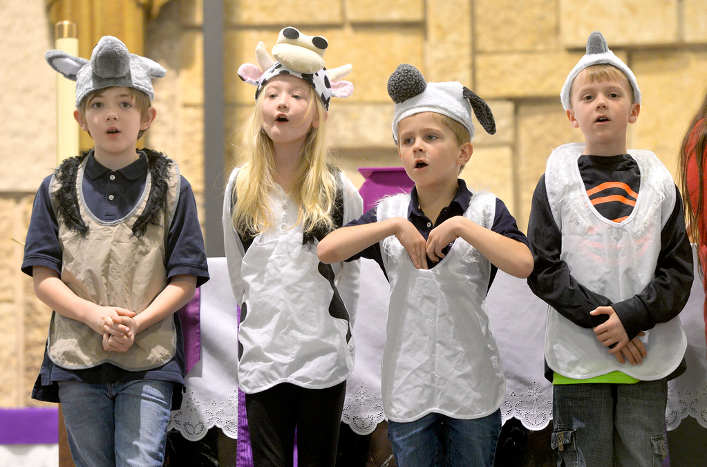 "Justin Sheely | The Sheridan Press<br /> From left, Parker Ford, Emma Sutton, Calloway Vaughn and Lawson Woodrow sing during the nativity program ""Through a Child's Eyes"" at Holy Name Catholic Church Wednesday, Dec. 20, 2017."