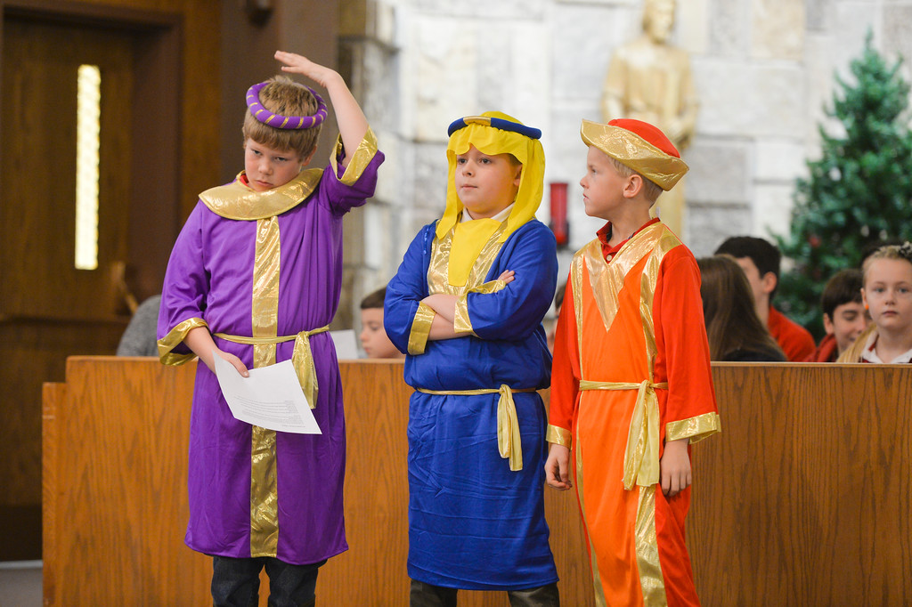 "Justin Sheely | The Sheridan Press<br /> Wise men, from left, Mondy Morris, Nolan King and John Vaughn wait for their song during the nativity program ""Through a Child's Eyes"" at Holy Name Catholic Church Wednesday, Dec. 20, 2017."