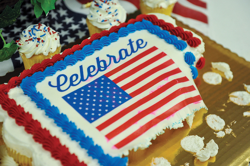 Ashleigh Fox | The Sheridan Press<br /> A cupcake cake decorated with the American flag sits half eaten following the naturalization ceremony Feb. 26 in 4th Judicial District Court.