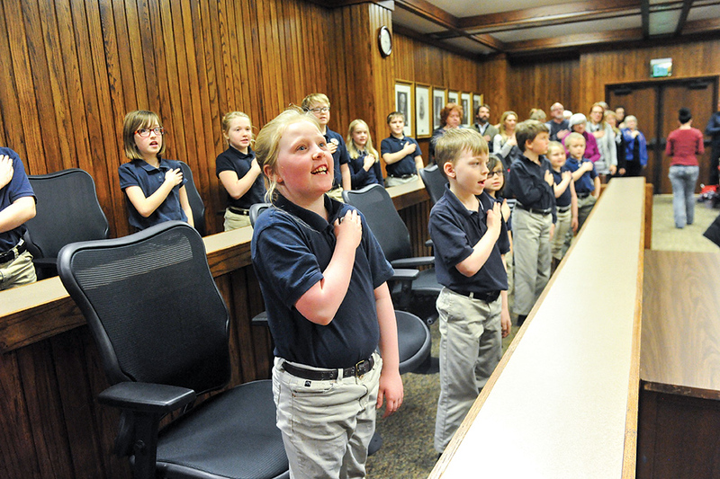Tibby McDowell | The Sheridan Press<br /> Students from the Martin Luther Grammar School join in on the Pledge of Allegiance during the naturalization ceremony in 4th Judicial District Court Monday, Feb. 26, 2018.
