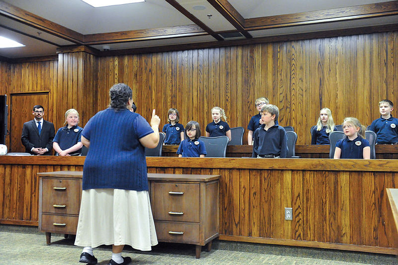 Tibby McDowell | The Sheridan Press<br /> Students from the Martin Luther Grammar School sing an American tune during the naturalization ceremony in 4th Judicial District Court Monday, Feb. 26, 2018.