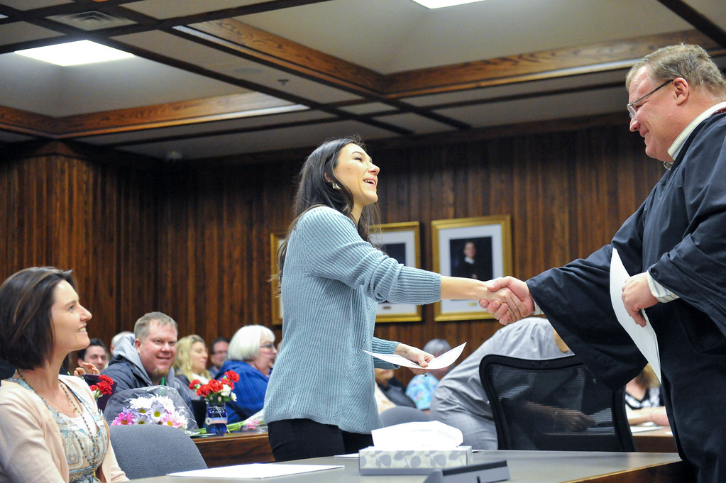 Tibby McDowell | The Sheridan Press<br /> Carla O'Leary from Brazil receives his citizenship certificate from Judge John Fenn Monday, Feb. 26, 2018.