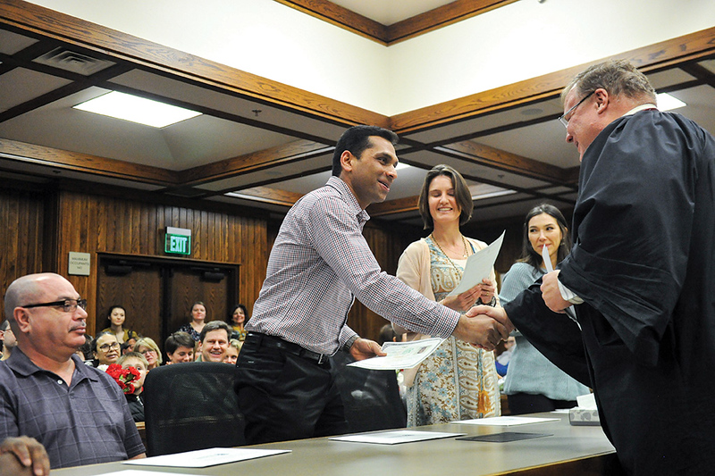 Tibby McDowell | The Sheridan Press<br /> Jins Ulahannan from India receives his certificate of citizenship from Judge John Fenn Monday, Feb. 26, 2018.