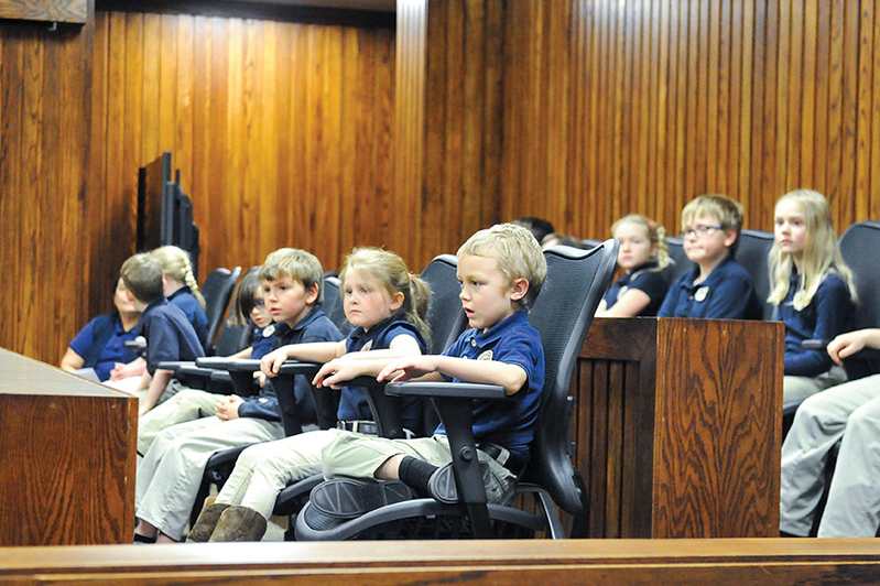 Tibby McDowell | The Sheridan Press<br /> Students from the Martin Luther Grammar School sit in the jury box in 4th Judicial District Court and wait for the naturalization ceremony to begin Monday, Feb. 26, 2018.