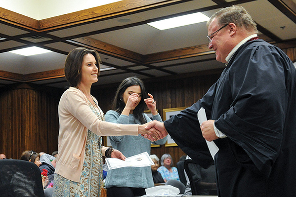 Tibby McDowell | The Sheridan Press<br /> Shannon Whittle from South Africa receives her certificate of citizenship from Judge John Fenn Monday, Feb. 26, 2018.