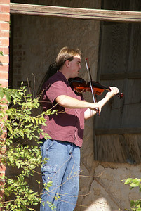 Southwestern College student Tim Miller, performing on violin at the limestone Baptist Church in Floral