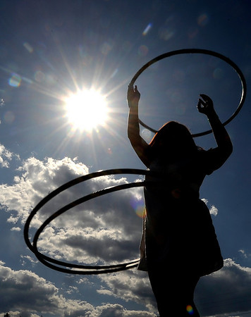 Christen Wilkinson spins multiple hula hoops at the first day of NedFest 2009 in Nederland, Colorado August 28, 2009. CAMERA/Mark Leffingwell