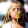 Allison Zeman, 6, blows bubbles while the band plays at the first day of NedFest 2009 in Nederland, Colorado August 28, 2009. CAMERA/Mark Leffingwell