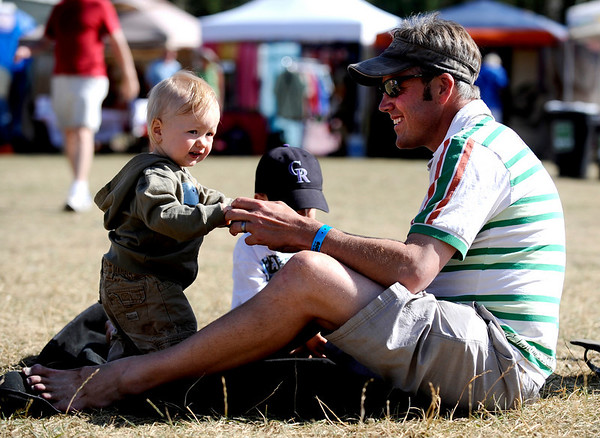 Gus Michaels (right) helps his daughter, Addison Michaels (left), dance at the first day of NedFest 2009 in Nederland, Colorado August 28, 2009. CAMERA/Mark Leffingwell