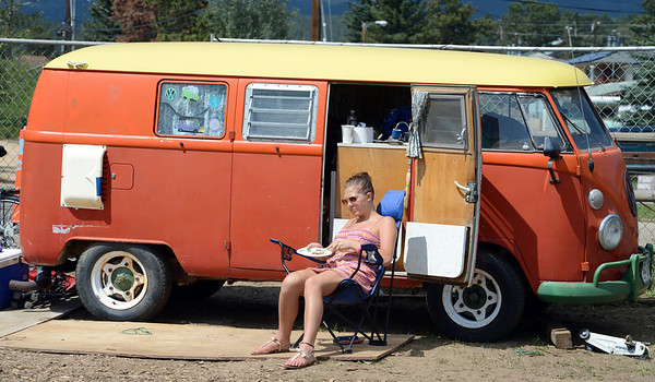 "Sarina Perret has breakfast outside ""Ollie"" the VW bus during the Nedfest on Sunday.<br /> For more photos and a  video of the Nedfest, go to  <a href=""http://www.dailycamera.com"">http://www.dailycamera.com</a>.<br /> Cliff Grassmick  / August 26, 2012"