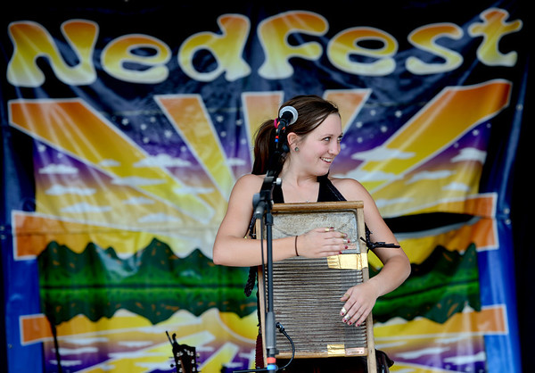 "Mackenzie Page of the group, Gipsy Moon, plays wash board at Nedfest on Sunday, August 26, 2012.<br /> For more photos and a  video of the Nedfest, go to  <a href=""http://www.dailycamera.com"">http://www.dailycamera.com</a>.<br /> Cliff Grassmick  / August 26, 2012"