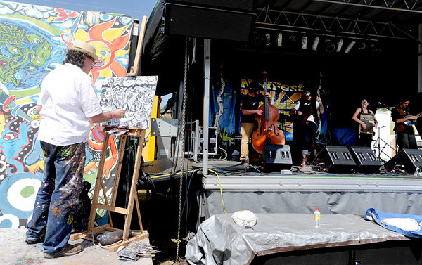 """Keith """"Scramble"""" Campbell, paints the band, Gipsy Moon while they are playing at the 14th Annual NedFest on Sunday.<br /> For more photos and a  video of the Nedfest, go to  <a href=""""http://www.dailycamera.com"""">http://www.dailycamera.com</a>.<br /> Cliff Grassmick  / August 26, 2012"""