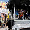 "Keith ""Scramble"" Campbell, paints the band, Gipsy Moon while they are playing at the 14th Annual NedFest on Sunday.<br /> For more photos and a  video of the Nedfest, go to  <a href=""http://www.dailycamera.com"">http://www.dailycamera.com</a>.<br /> Cliff Grassmick  / August 26, 2012"