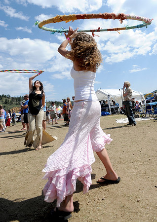"""Jen Shapiro, back left, and Hart Castleberry, dance with a hula hoop to the music of Gipsy Moon at the 14th Annual Nedfest on Sunday.<br /> For more photos and a  video of the Nedfest, go to  <a href=""""http://www.dailycamera.com"""">http://www.dailycamera.com</a>.<br /> Cliff Grassmick  / August 26, 2012"""