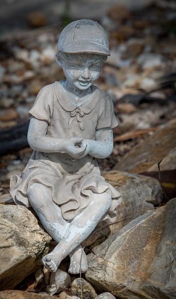 Little boy sculpture