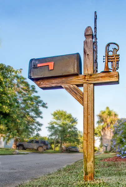 A mailbox with a Cornet and Flute mounted on it
