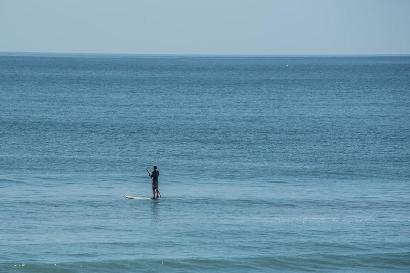 A guy Paddle Boarding in the Atlantic Ocean