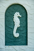 Seahorse decoration in front of an old house