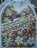 Front of a mailbox with tiny seashells