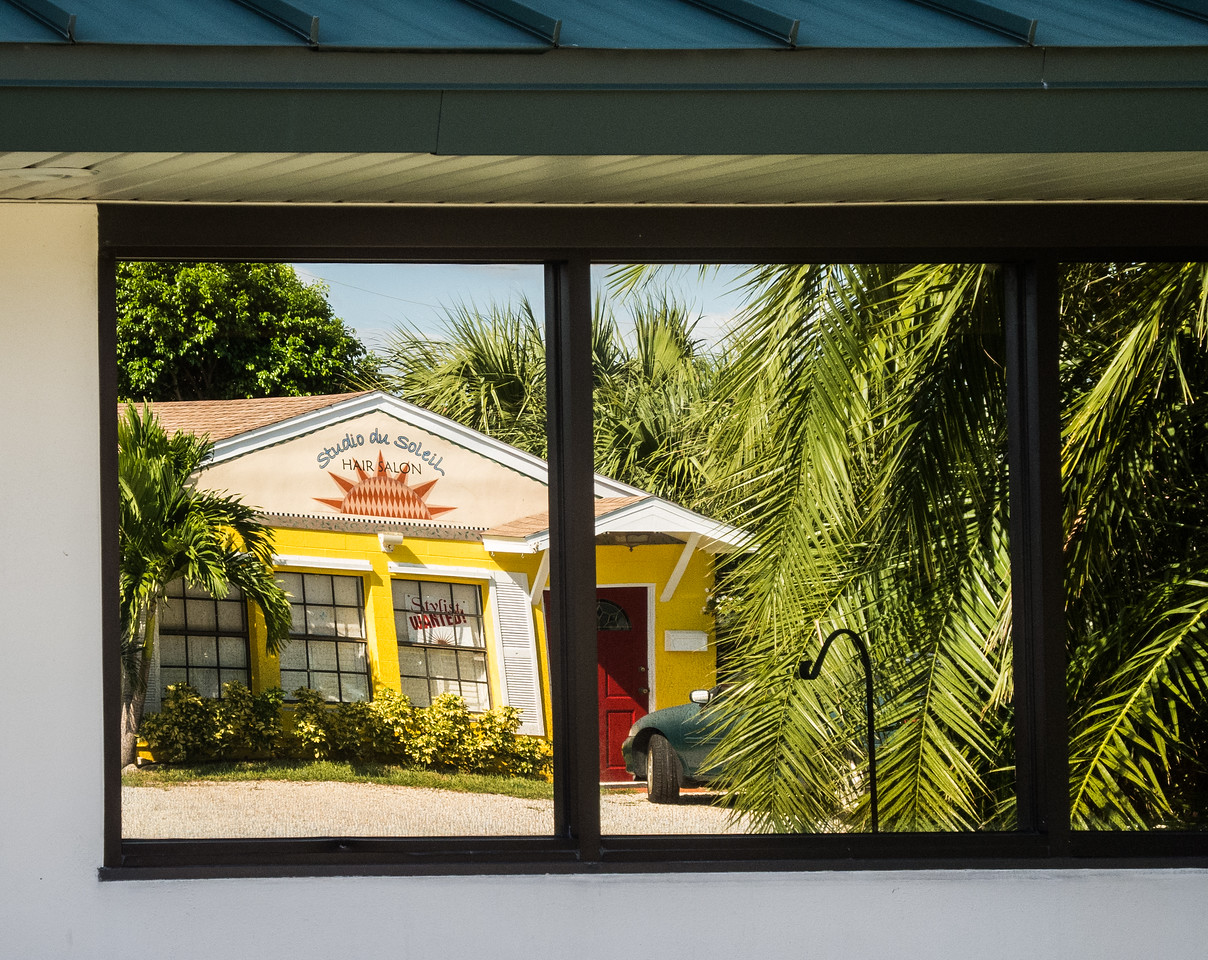 This is a reflection of the Studio Du Soleil store front on Palm Ave in Indialantic, Fl.  Yes, I flip this photo horizontally.