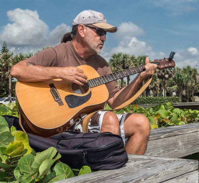 This guy was sitting at the boardwalk in Indialantic Beach singing and playing is Guitar.