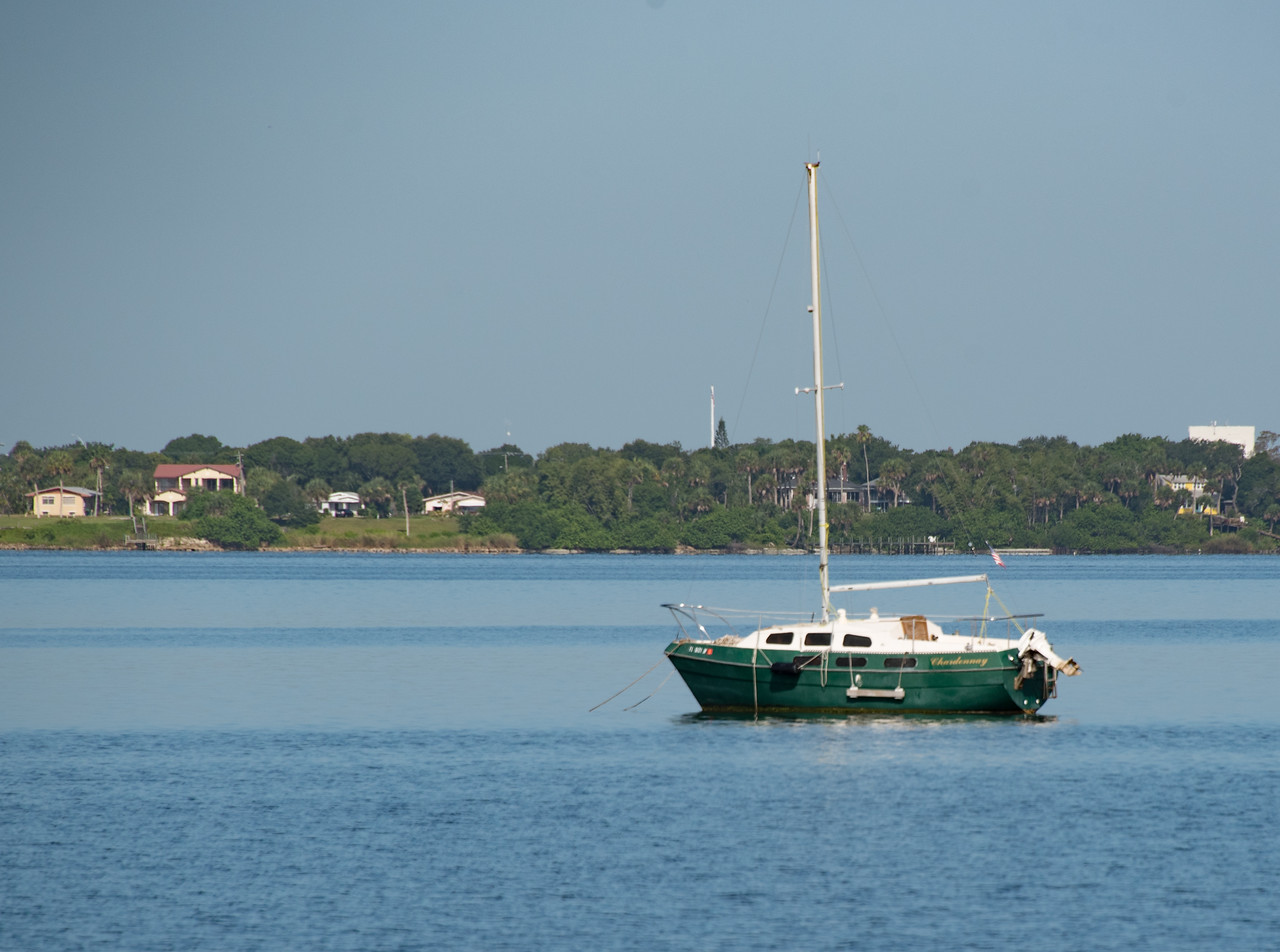 • Location - Melbourne Beach<br /> • A sailboat anchored in the middle of the Indian River