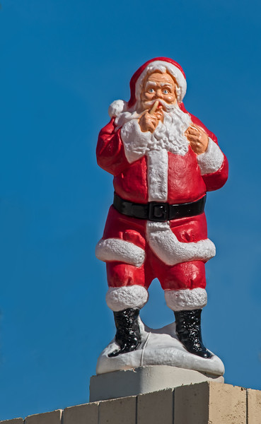 Santa Claus on top of the roof