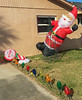 Inflatable Santa Claus getting a little wind blown