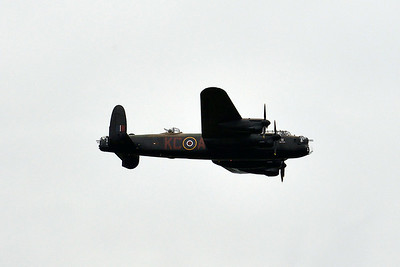 The Lancaster flies over