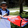 "Shrish Sharma, 8, has fun with the flag of Nepal before the parade on Saturday.<br /> Residents in and around Boulder, celebrated Nepal Day 2011 with a parade down Pearl Street.<br /> For a video and photo gallery of the Nepal Day, go to  <a href=""http://www.dailycamera.com"">http://www.dailycamera.com</a>.<br /> Cliff Grassmick/ April 16, 2011"