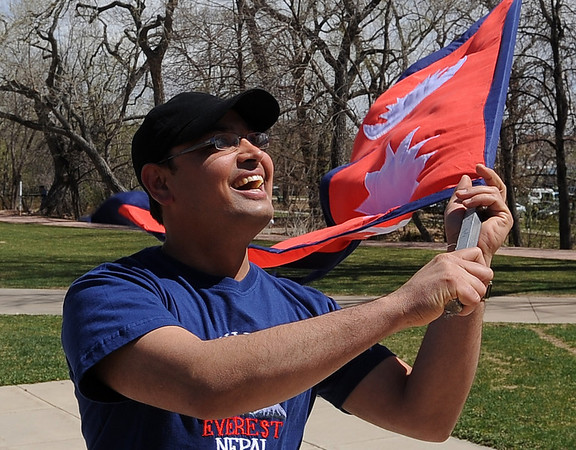 "Nawaraz  Maraseni lets the Nepal flag blow in the wind before the parade.<br /> Residents in and around Boulder, celebrated Nepal Day 2011 with a parade down Pearl Street.<br /> For a video and photo gallery of the Nepal Day, go to  <a href=""http://www.dailycamera.com"">http://www.dailycamera.com</a>.<br /> Cliff Grassmick/ April 16, 2011"