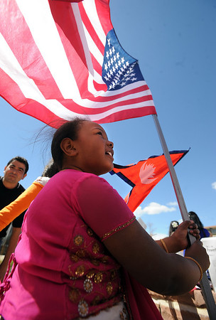 "Nailah Falker, 6, sits under a US Flag before the parade on Saturday.<br /> Residents in and around Boulder, celebrated Nepal Day 2011 with a parade down Pearl Street.<br /> For a video and photo gallery of the Nepal Day, go to  <a href=""http://www.dailycamera.com"">http://www.dailycamera.com</a>.<br /> Cliff Grassmick/ April 16, 2011"