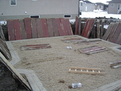 looks like the put in the rocks and gravel for under the floor and the forms for the basement cement are about to go up.  Feb 15th, 2007