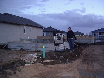 Our garage Footings and a sign that says we bought the place. March 21,2007