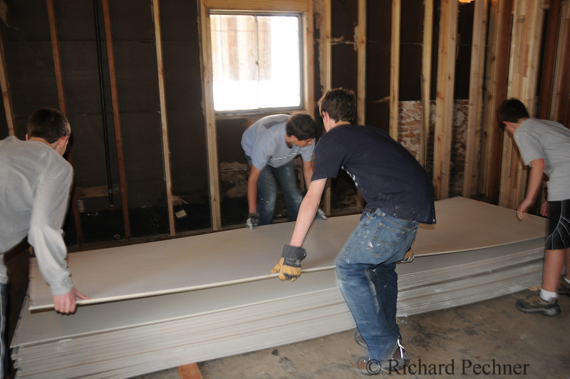 """We offered to move 32 sheets of 1/2"""" X 12 ' sheetrock to house on the other side of the river that needed the rock."""