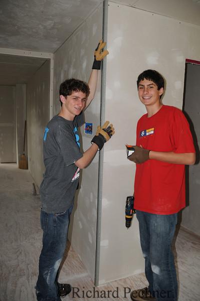 Michael and James installing a metal corner.