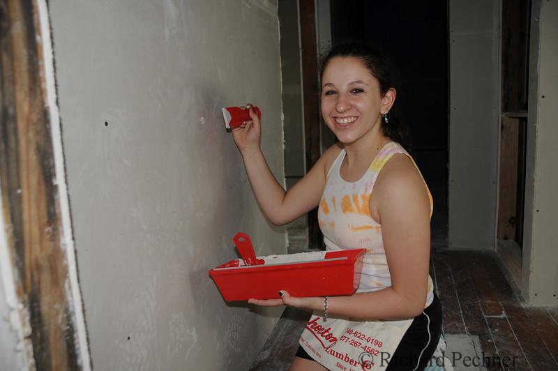Sofi mudding the screw holes.