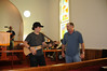 Toby & David leading a morning song in the Church before we receive our work assignments.