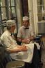 2 servers taking a break at Cafe Du Monde.