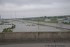 View from the bridge looking into the water being held back by the new levy protecting the Lower 9th Ward.