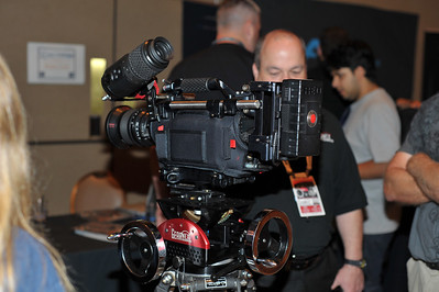 Photograph of Red Camera, Scarlet, Epic, Classic, Houston at NAB RedUser 2009 in the Amazon Ballroom at Rio Casino and Hotel. Red Camera demonstrations and 3rd party vendor products for new products invented for use with Red Camera. Including the new Scarlet with its DSMC System for Cinema, Pro Cinema, the 645, FF35, S35 for Prime Lens in these photographs. Redcode. Redone.