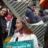 A woman wearing a model of a New York City bridge as a hat in New York City's Easter Parade