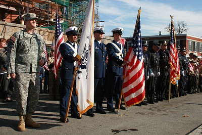 The US Coast Guard, Essex County Sherriff and State Police Color Guard stand at attention at Brown's Square during the Newburyport Veteran's Day Parade.