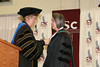 Chadron State College President Dr. Janie Park presents CSC's Distinguished Alumni Award to Dr. Leanna Scott-Timperley during Saturday's ceremony. (Photo by Justin Haag/Chadron State College)