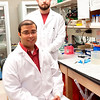 Marshall University Joan C. Edwards School of Medicine biomedical sciences Ph.D. students Johannes Fahrmann, standing, and Rounak Nande, seated, captured first place in their respective categories at a research competition held earlier this month in conjunction with the first Appalachian Regional Cell Conference. Fahrmann won the oral presentation category and Nande took first place in the poster category.