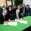 Andrew Colin, left, chairman of INTO University Partnerships, and Marshall President Dr. Stephen J. Kopp sign an agreement Nov. 15 that is expected to build the institution's global profile and increase international student enrollment at the university. The signing took place on Marshall's Huntington campus at the Marshall University Foundation Hall, home of the Erickson Alumni Center.