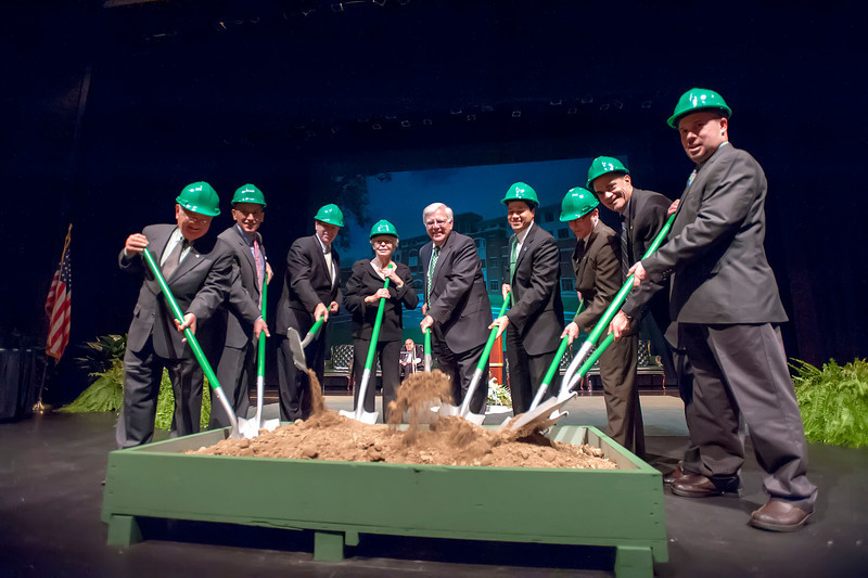 Marshall President Stephen J. Kopp, center, leads a ceremonial groundbreaking marking the start of construction of the Arthur Weisberg Family Applied Engineering Complex. The event took place in the Joan C. Edwards Performing Arts Center. Pictured are, from left, A. Michael Perry, Louis Weisberg, Sen. Robert Plymale, Joan Weisberg, Dr. Kopp, Dr. Wael Zatar, Dr. Chuck Somerville, Dr. John Maher and Chuck Moore.